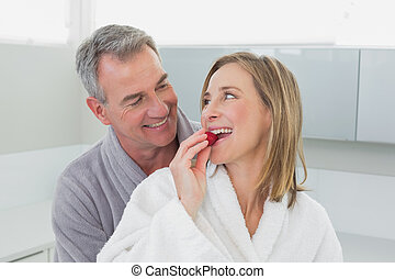 Loving couple looking at each other in kitchen