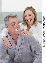 Loving couple in bathrobes in kitchen - Portrait of a loving...