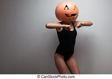 Dancing Halloween go-go dancer girl. Grey background. Idea...