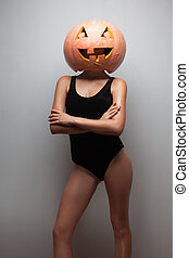 Sexy body woman with a halloween pumpkin on head Pumpkinhead...