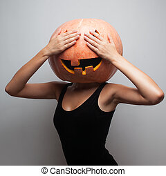 Funny pumpkin face Dancer in Halloween costume Covered eyes...