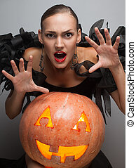 scaring model with halloween pumpkin