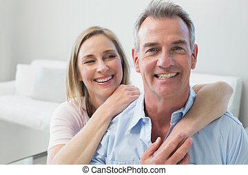 Close-up portrait of a loving couple in the living room at...