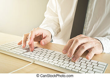 Businessman typing on his computer