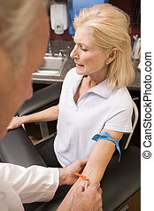 Middle Aged Woman Having Blood Test Done