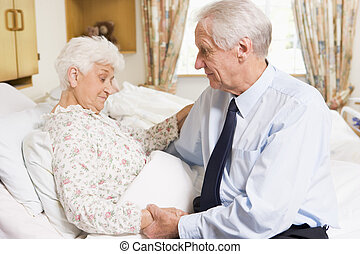 Senior Man Visiting His Wife In Hospital