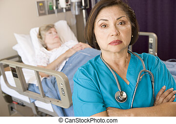 Doctor Standing With Arms Crossed In Patients Room