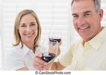Close-up of a couple toasting wine glasses - Close-up of a...