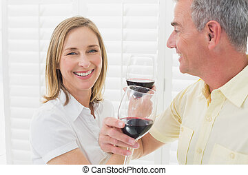Happy couple toasting wine glasses - Close-up of a happy...