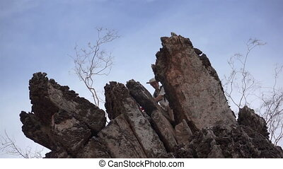 Male Climber with Red Flag - Male climber on treacherous...