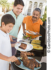 Family Enjoying A Barbeque