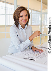 Confident businesswoman smiling at office