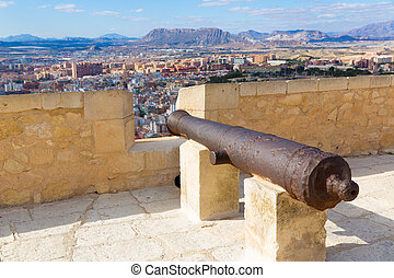 Alicante skyline and old canyons of Santa Barbara Castle in...