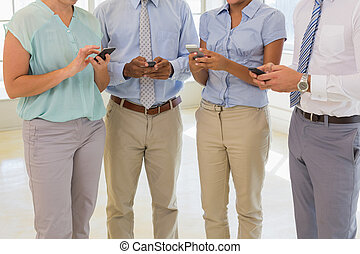 <id section of business colleagues text messaging -...