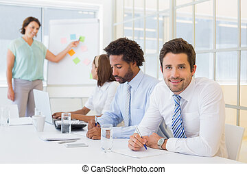 Businessman with colleagues in boardroom meeting
