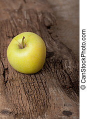 Apple on wooden board