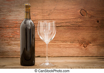 Wine bottle and elegant glass on wooden boards - Wine bottle...