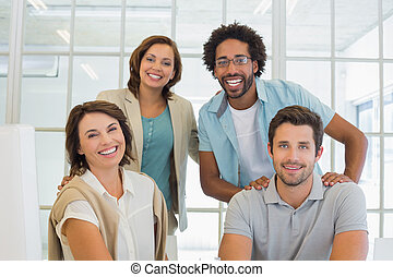 Group portrait of happy business people in office - Group...