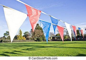 Bunting - Colorful bunting flags in a park on a suny day