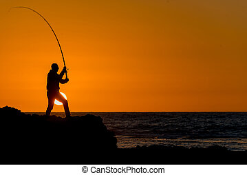 fisherman - Fisherman catches at dawn, early summer morning