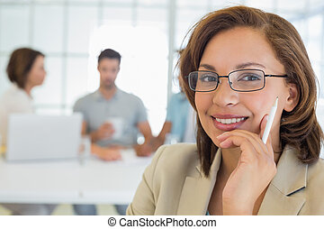 Smiling businesswoman with colleagues in meeting
