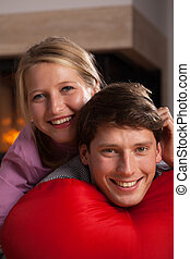 Smily couple in love - A closeup of a smily couple lying on...