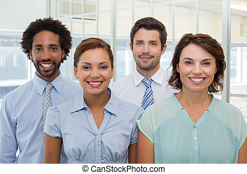 Smiling young business people in office - Group portrait of...