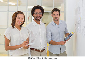 Business people with digital tablet and notepad at office