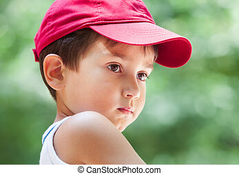 Portrait of a 3-4 years boy playing on soft nature...