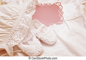 Baby shoe with blank invitation card