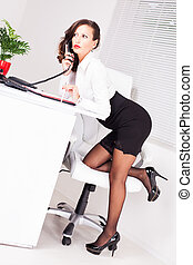 Sexy secretary - Sexy business woman standing and Leaning on...