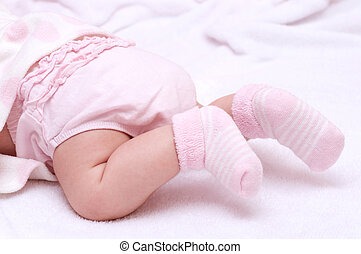 Newborn baby girl feet in pink socks