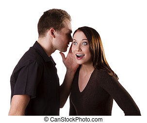 Tell me a secret! - Handsome young man whispers to the...
