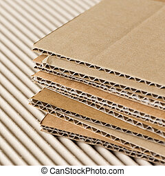 Cardboard pile on corrugated fiber board background