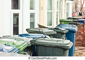 Rubbish bins - Household waste bins outside on a street in...