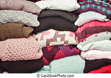 Wool jumpers - Stacked wool jumpers as a background