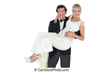 Handsome groom carrying bride - Portrait of handsome groom...