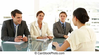 Businesswoman being interviewed and offered job -...
