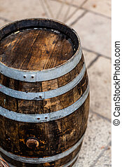 Barrel - an old and weathered wooden barrel in a medieval...