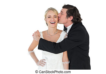 Groom kissing attractive bride - Loving groom kissing...