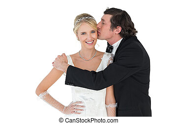 Bride being kissed by groom - Portrait of beautiful bride...