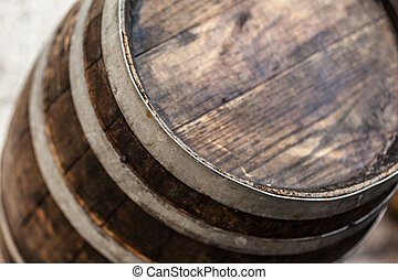 Barrel detail - an old and weathered wooden barrel in a...