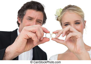 Bride and groom looking at wedding rings - Loving bride and...