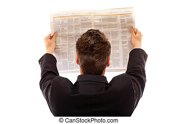 Businessman reading a newspaper isolated - Businessman from...