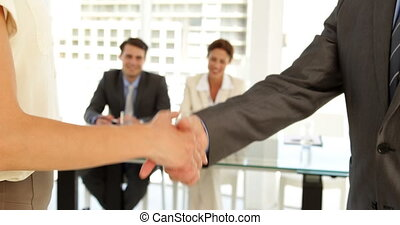 Business people shaking hands at the office