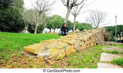 Wide shot of woman in park working - Beautiful woman working...