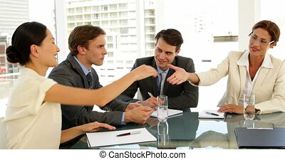 Business people shaking hands at interview at the office