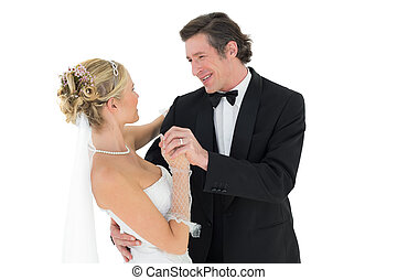 Bride and groom dancing over white background - Happy bride...