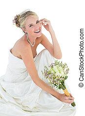 Happy bride holding flower bouquet - Portrait of happy bride...