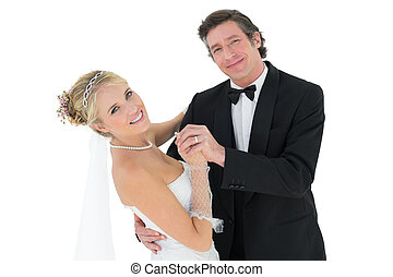Happy couple dancing over white background